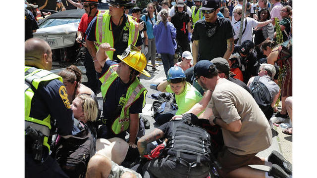 1 dead, 19 injured after car plows into protesters in Virginia