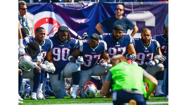 NFL players kneel, raise fists, lock arms during national anthem