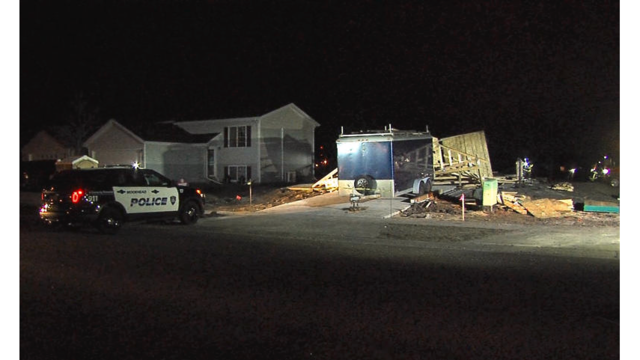 Winds knock over house under construction