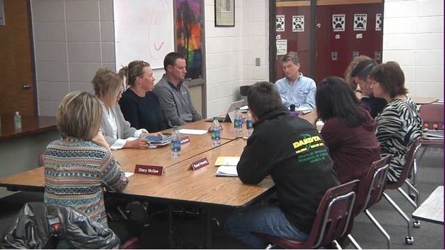 School board suspends superintendent without pay